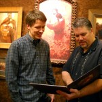 Kirk and Will looking at Kirk's new book.