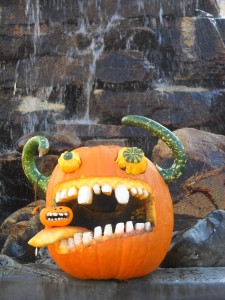 Big mouth pumpkin with horns and crazy eyes.