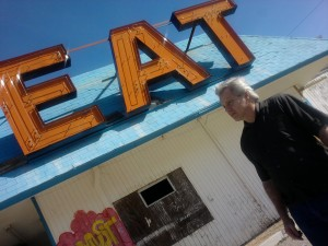 Wayne In font of a cool old vacant diner in or near Vegas