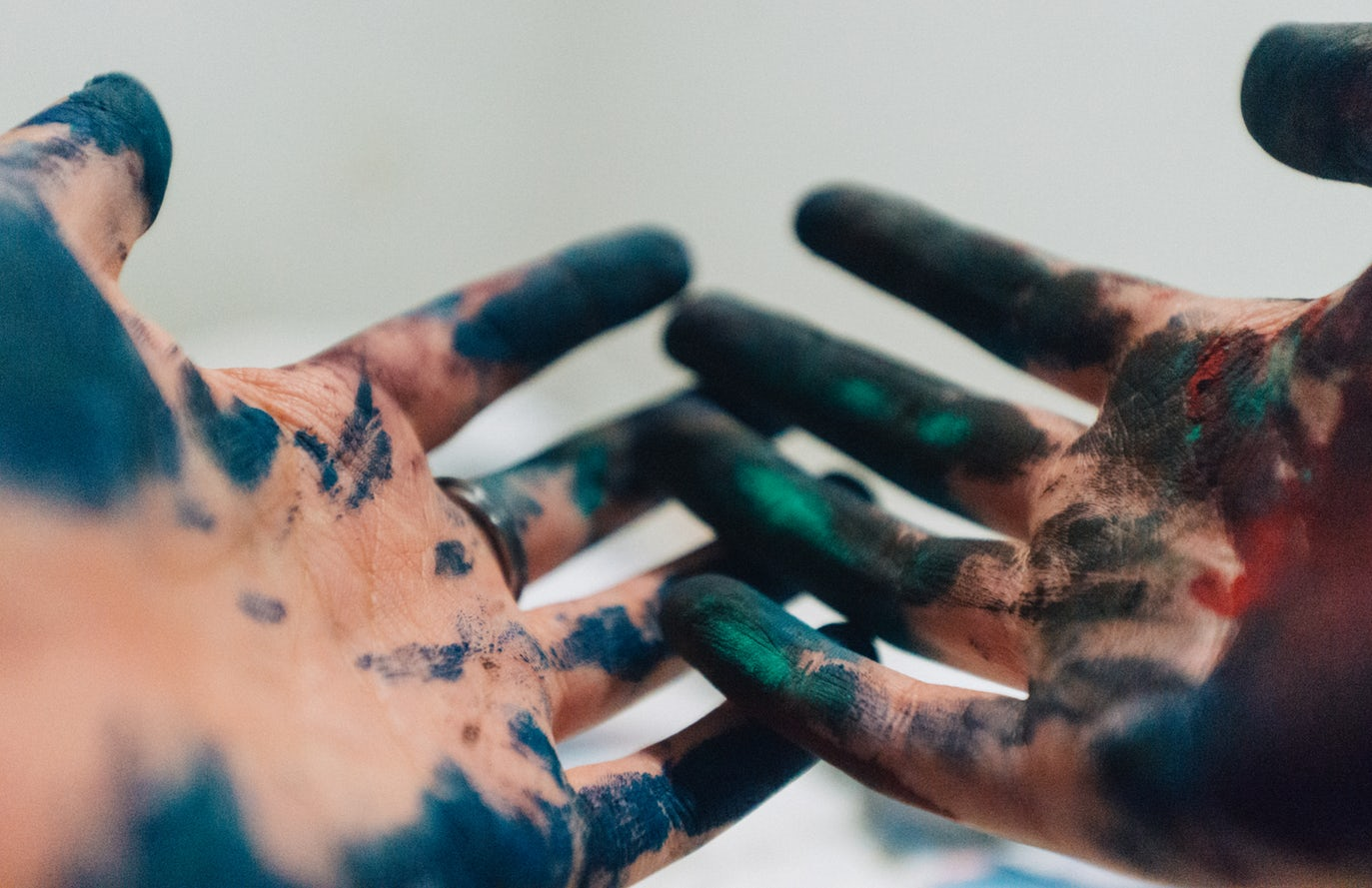 Artist's hands with paint on them